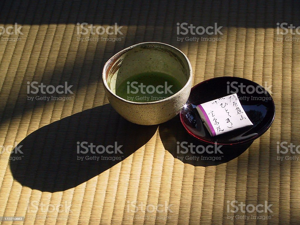 Green tea in traditional cup with a snack royalty-free stock photo