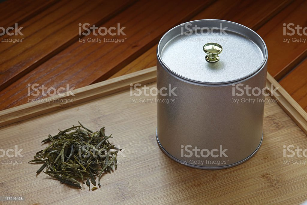green tea leaf and metal can stock photo