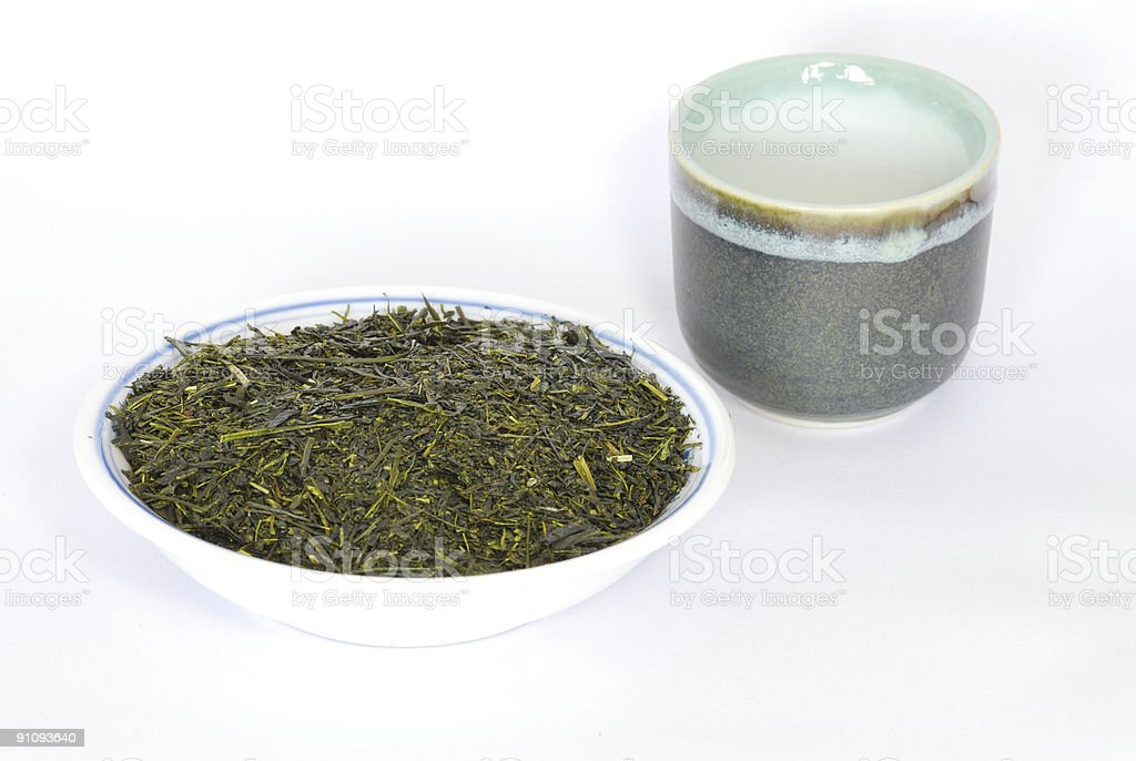 Green Tea leaves and cup royalty-free stock photo