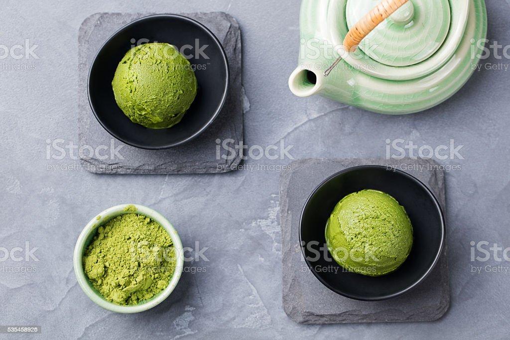 Green tea matcha ice cream scoop in bowl stock photo