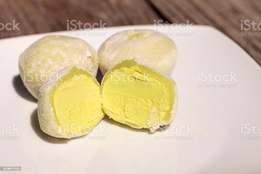 Green tea mochi ice cream bonbon stock photo