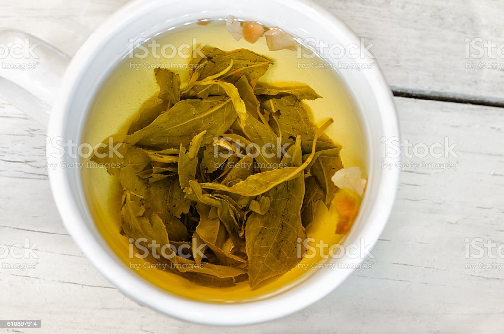 Green tea on white cup. Close up stock photo