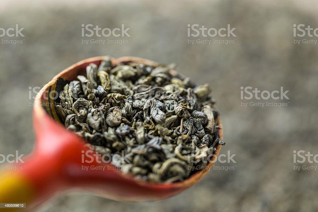 Green tea on wooden spoon. stock photo