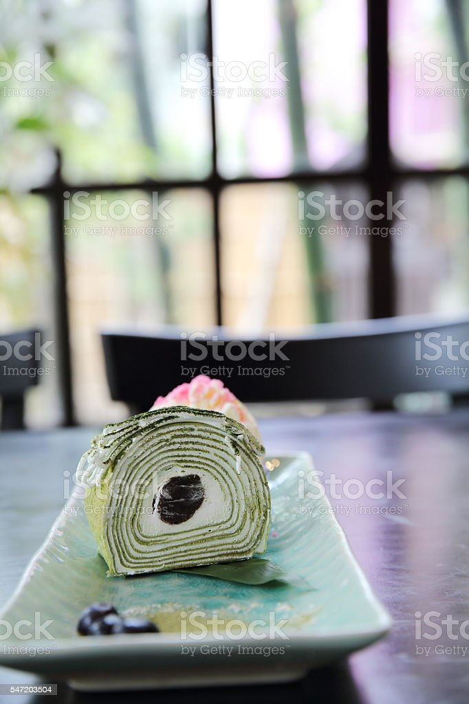 green tea roll cake with ice cream stock photo