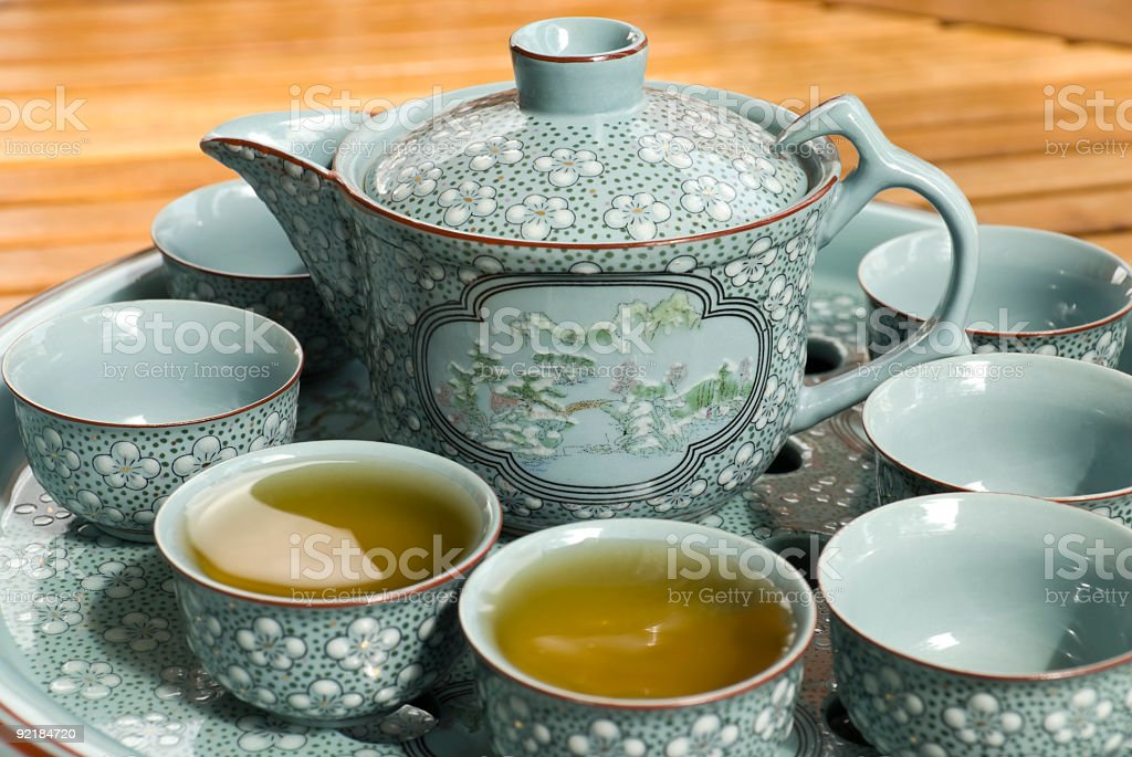 Green tea served in china service stock photo