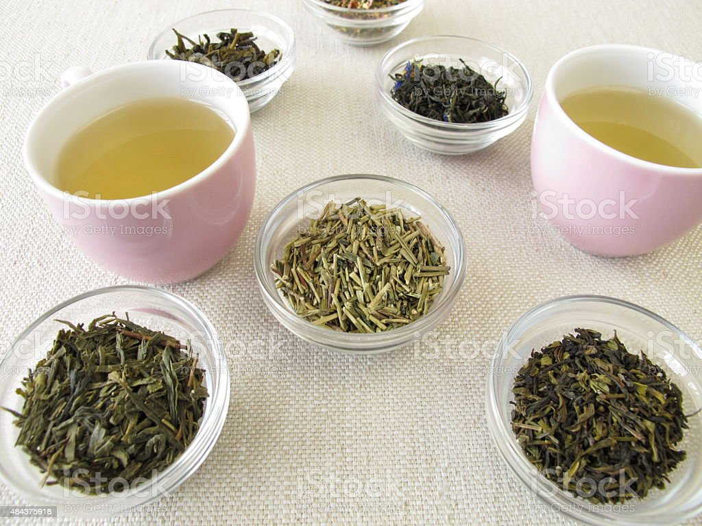 Green tea varieties and two cups of tea stock photo