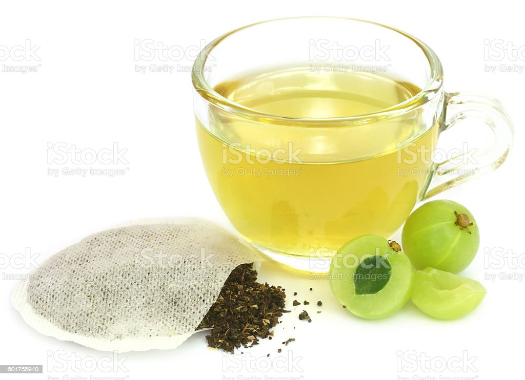 Green tea with ampla fruit stock photo