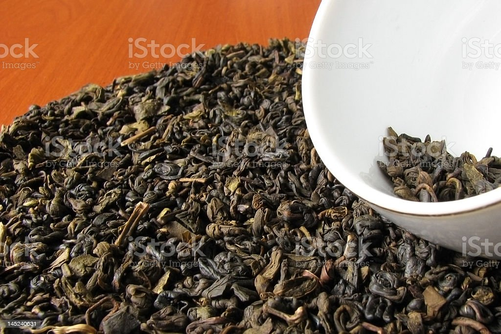 Green tea with cup on a table royalty-free stock photo