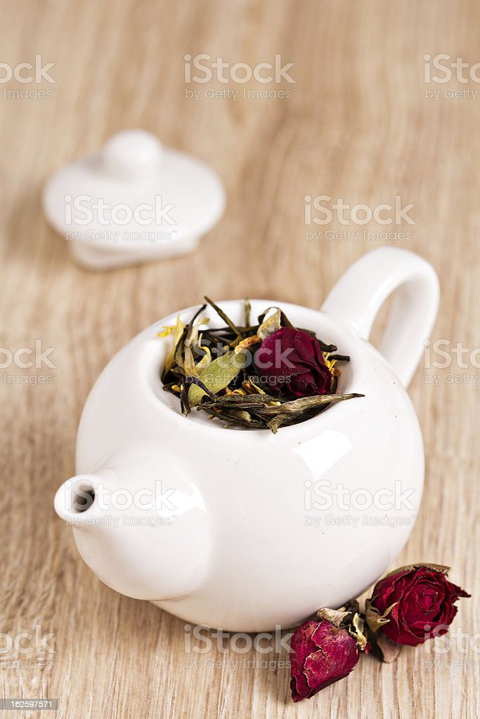 Green tea with fruits, spices and rose petals royalty-free stock photo