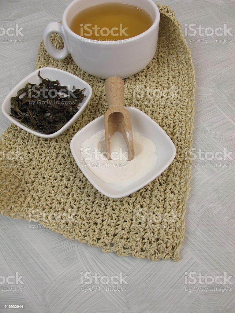 Green tea with gelatin powder stock photo