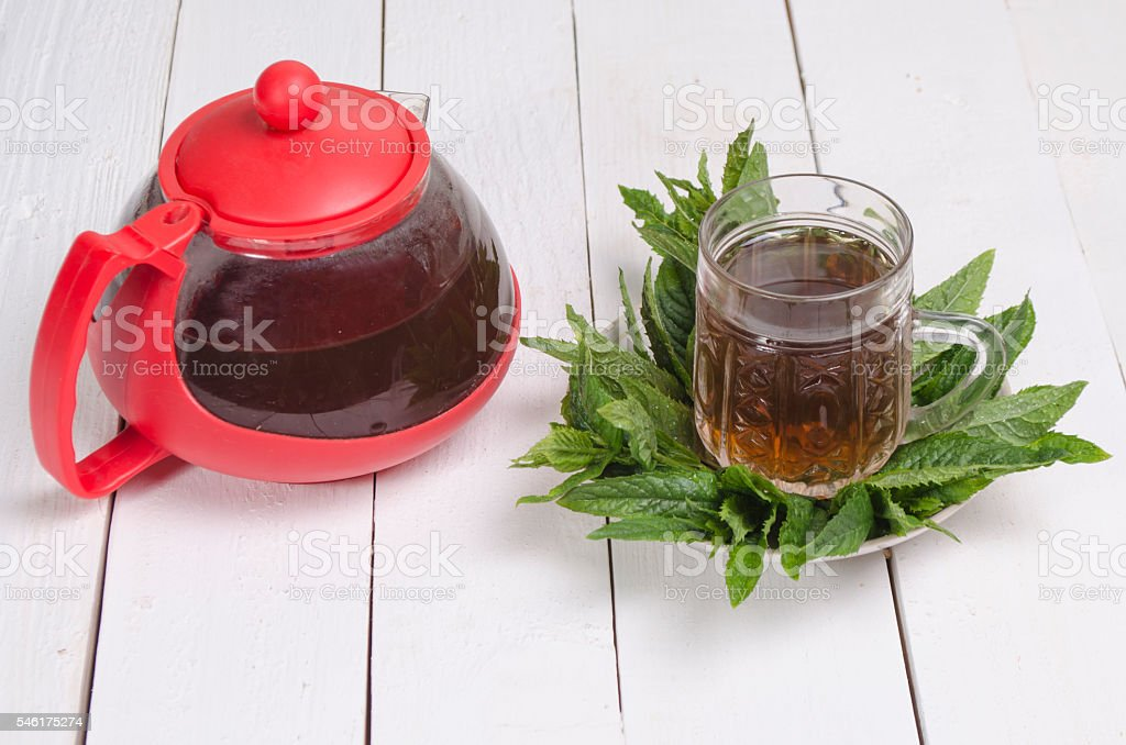 green tea with herbs stock photo