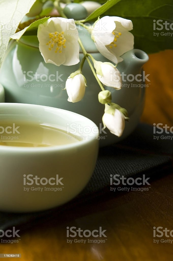 Green tea with jasmine in cup and teapot royalty-free stock photo