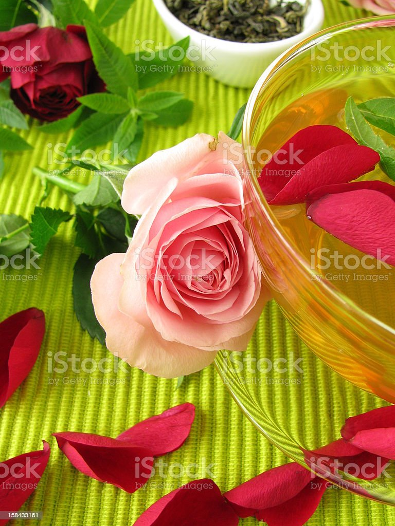 Green tea with rose flowers and lemon verbena royalty-free stock photo