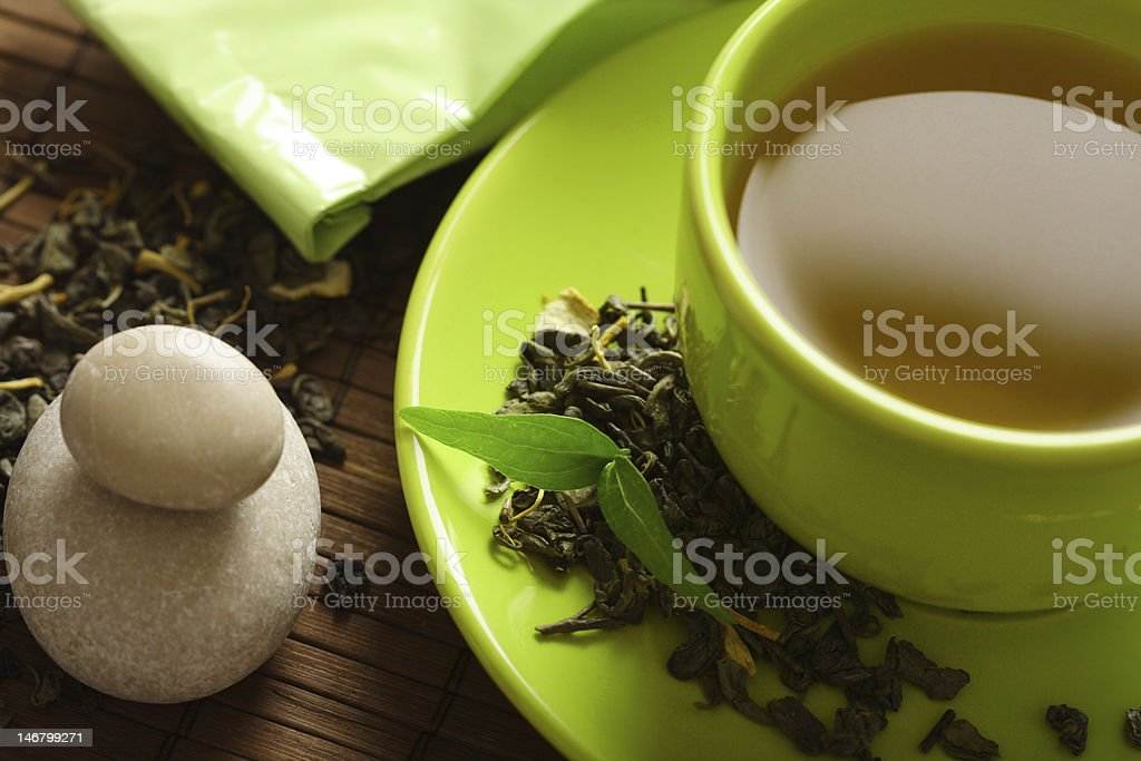 Green tea with tea leaves stock photo