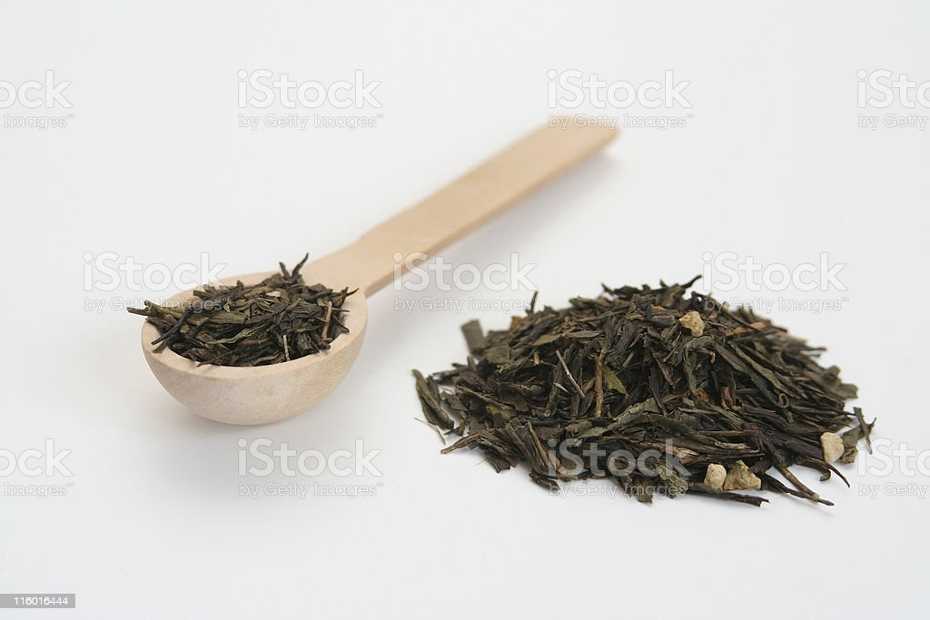 Green tea with wooden spoon royalty-free stock photo