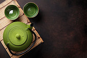 Green teapot and tea cups