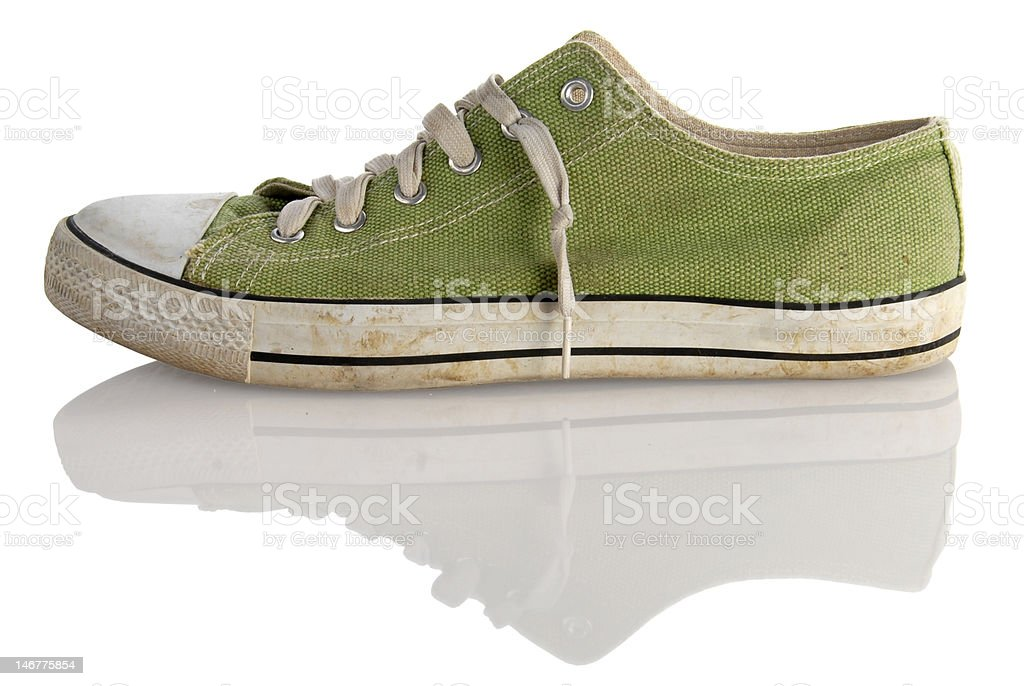 green teenager dirty sneaker on white background stock photo