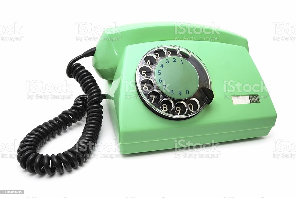 Green telephone with a disk royalty-free stock photo