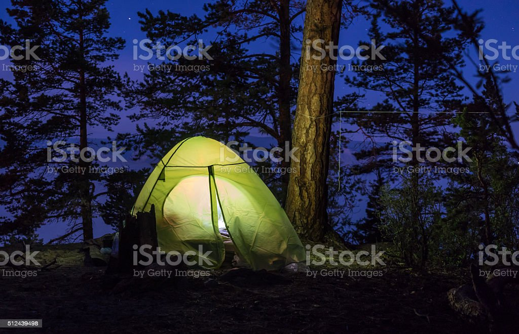 Green tent at night stock photo