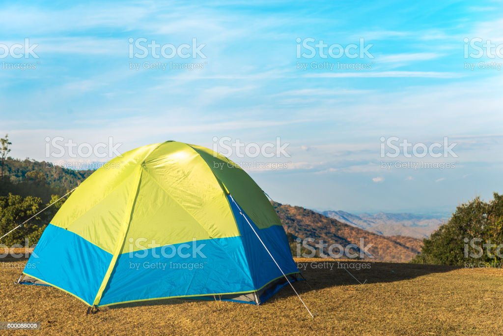 Green tent camping with sunshine in wilderness stock photo