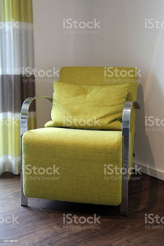 Green textile armchair stock photo