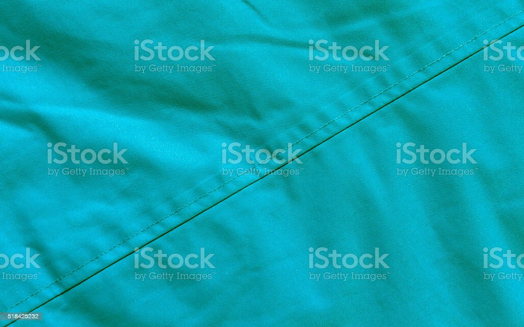 Green textile texture close-up. stock photo