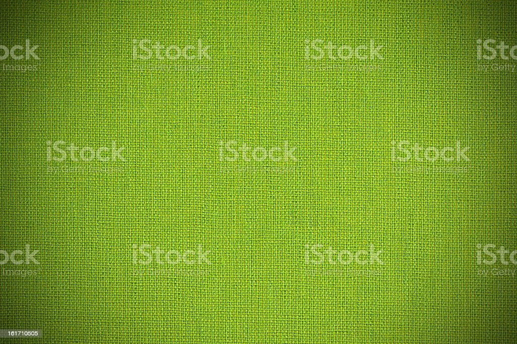 green textile wallpaper with vignette royalty-free stock photo