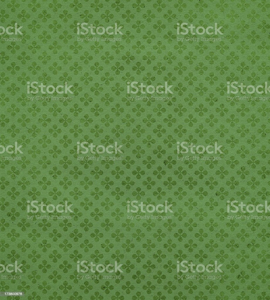 green textured paper with clover stock photo