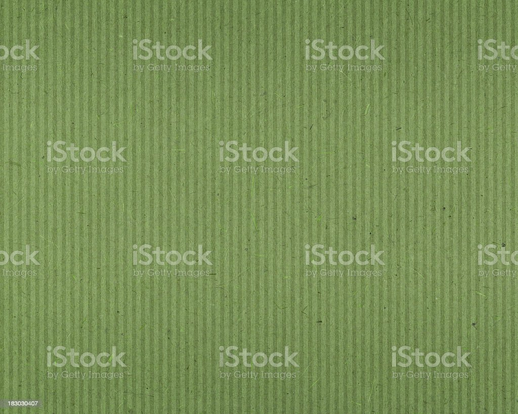 green textured paper with vertical lines stock photo
