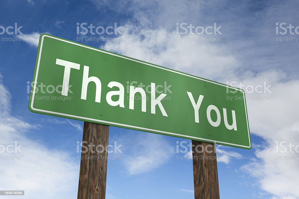 Green thank you sign over a blue sky background royalty-free stock photo