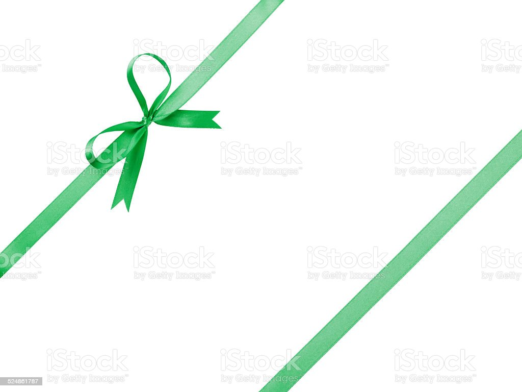 green thin ribbon with bow composition stock photo