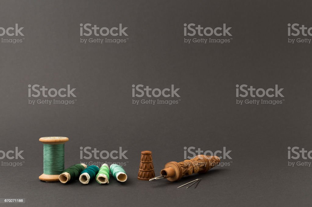Green thread spools with needles stock photo