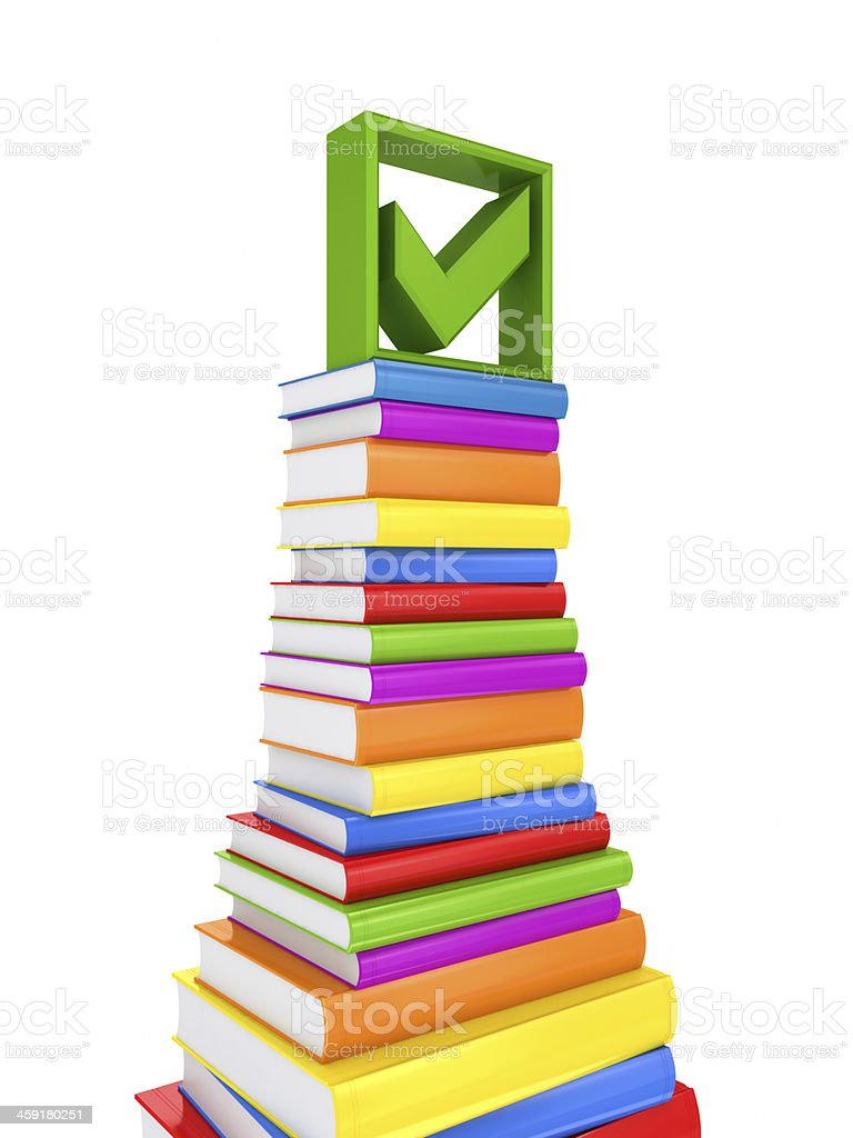 Green tick mark on a big stack of colorful books. royalty-free stock photo