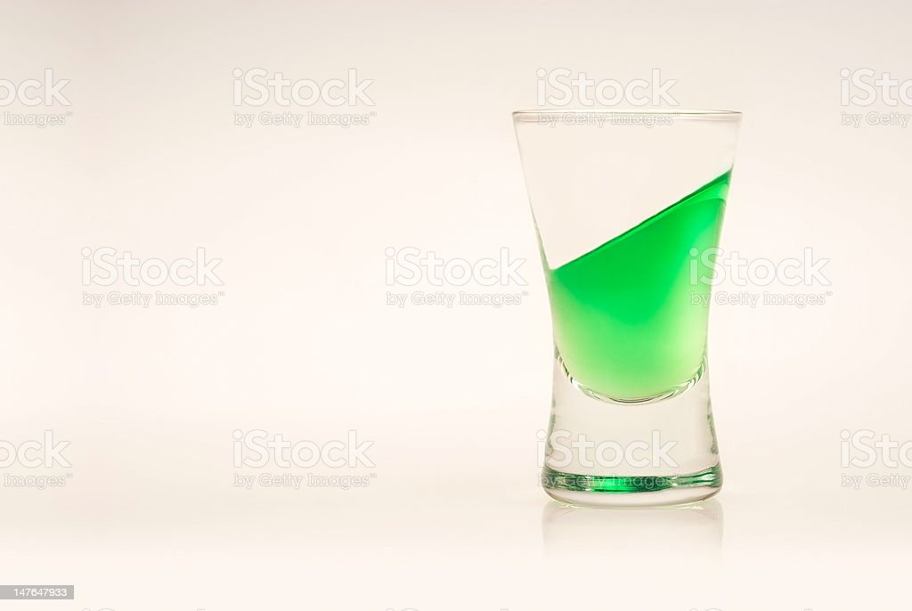 Green tilted drink stock photo