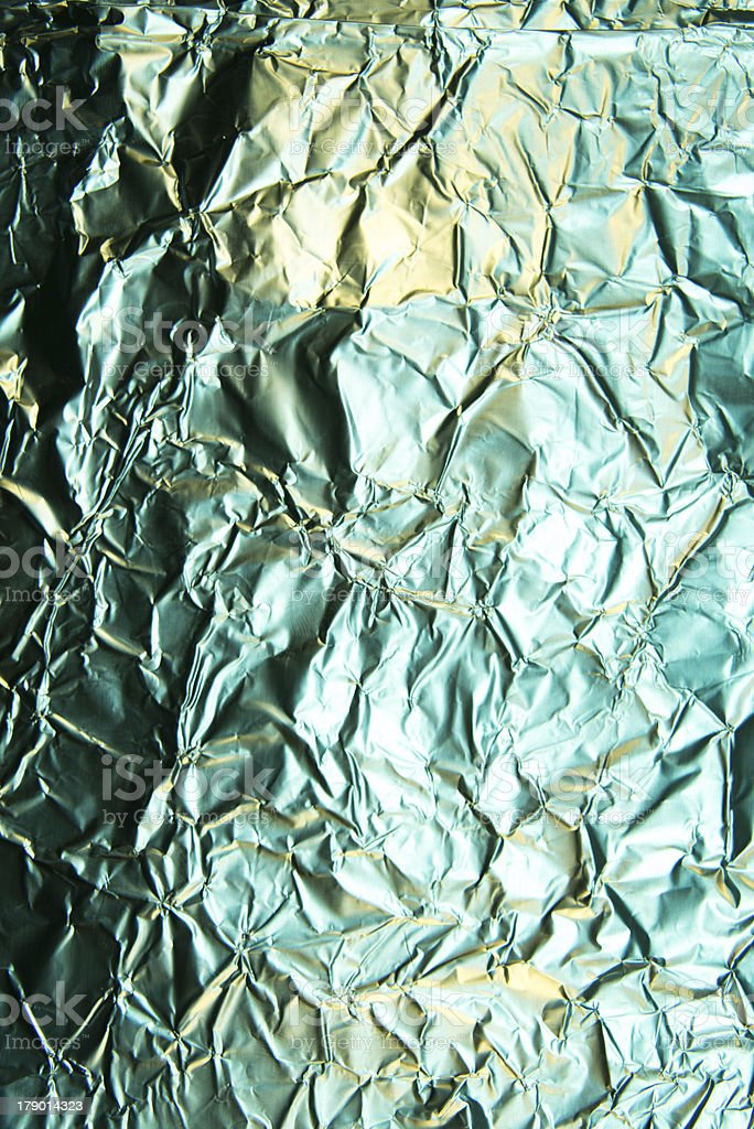 Green tinged Silver foil textured background stock photo