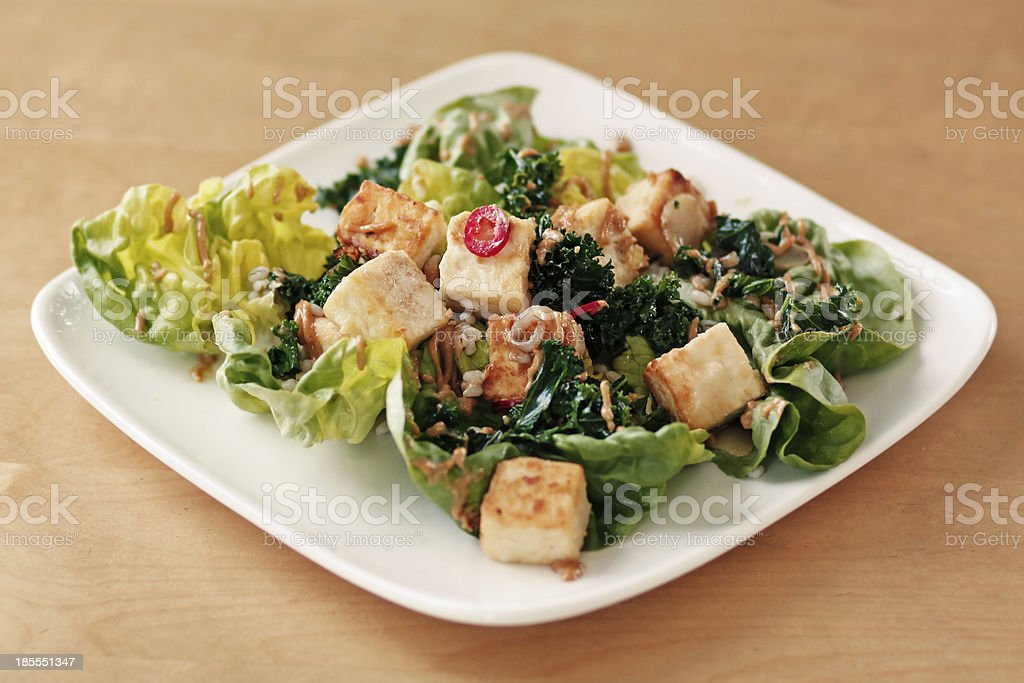 green tofu salad with Asian toppings stock photo