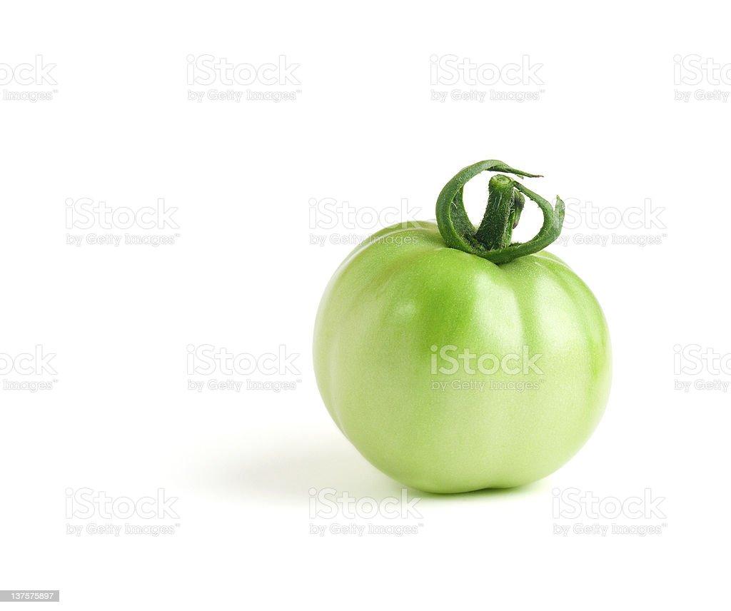Green Tomato on White stock photo