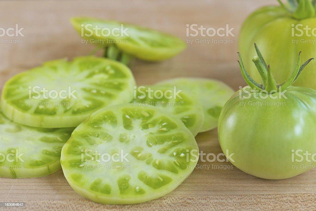 Green Tomatoes on Wood Cutting Board stock photo