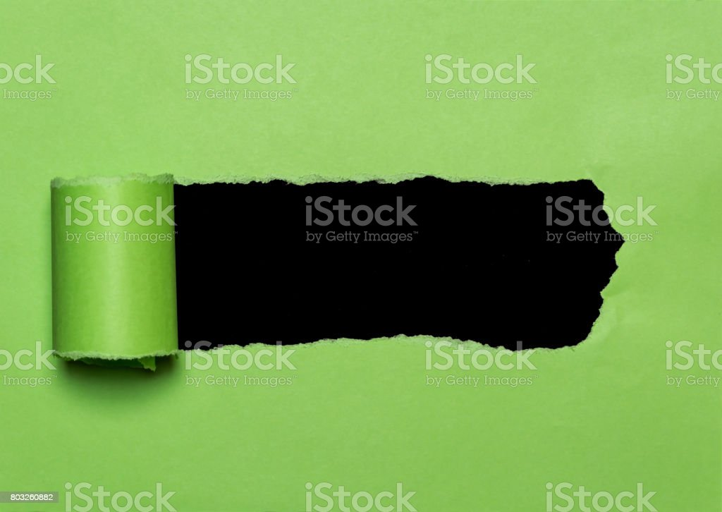 Green torn paper with opening black space for text. Paper scroll background stock photo
