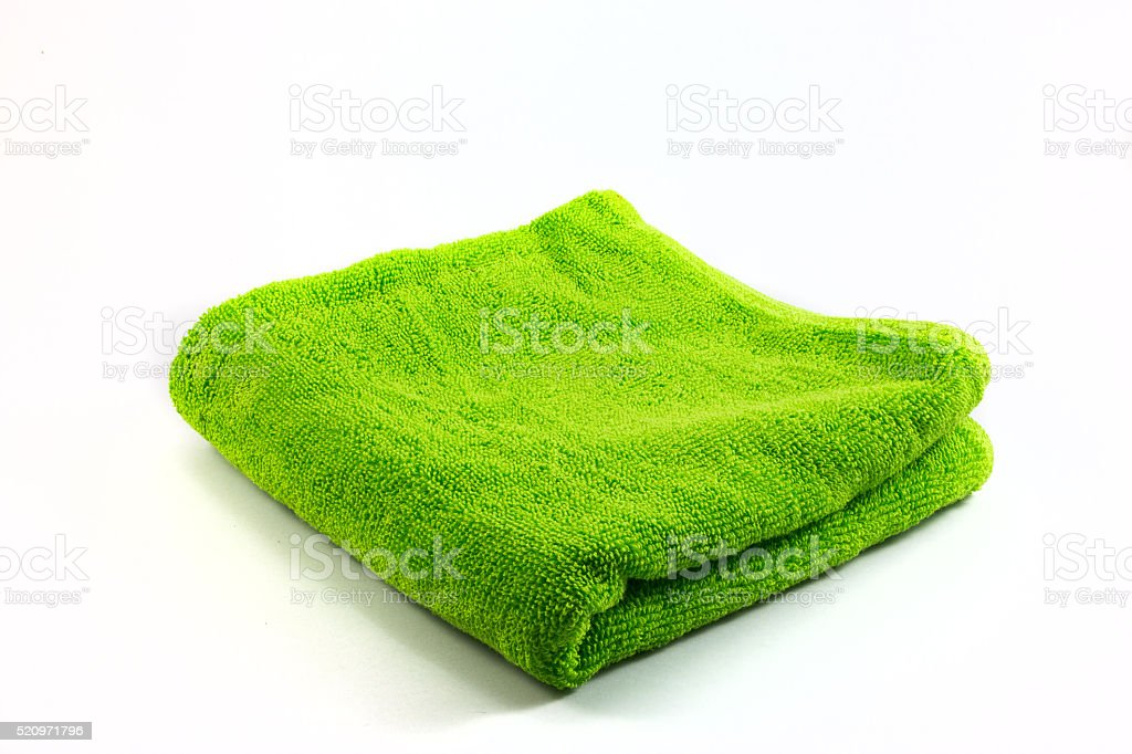 Green towel handkerchief isolated on white background stock photo