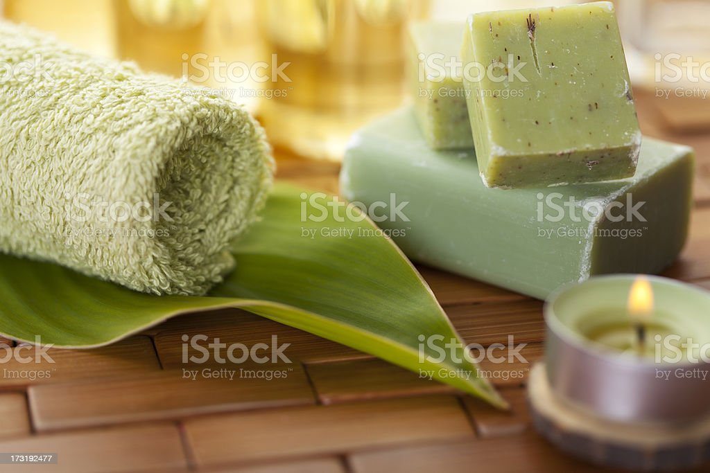 Green towel, leaf, soap and candle royalty-free stock photo