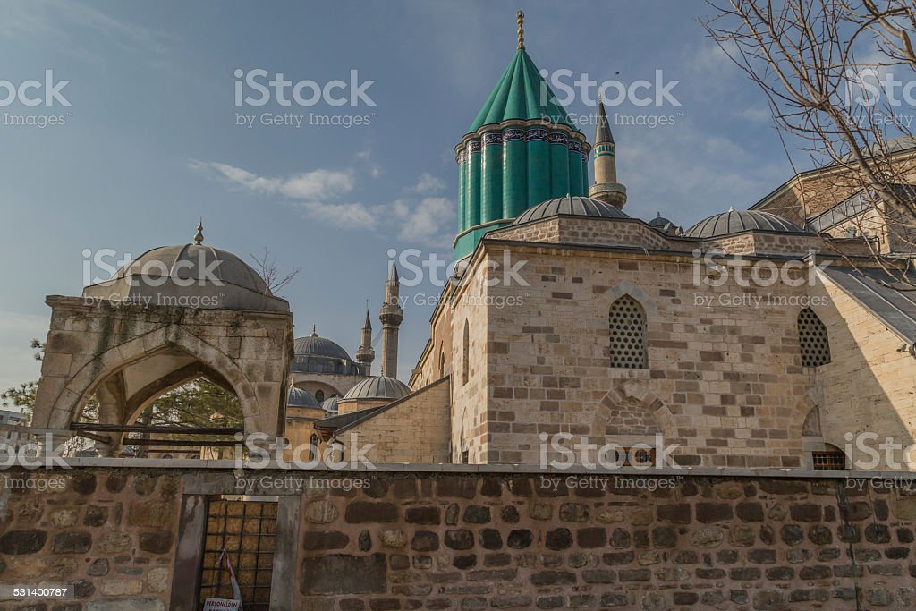 Green tower raising above Mevlana sarqufague stock photo