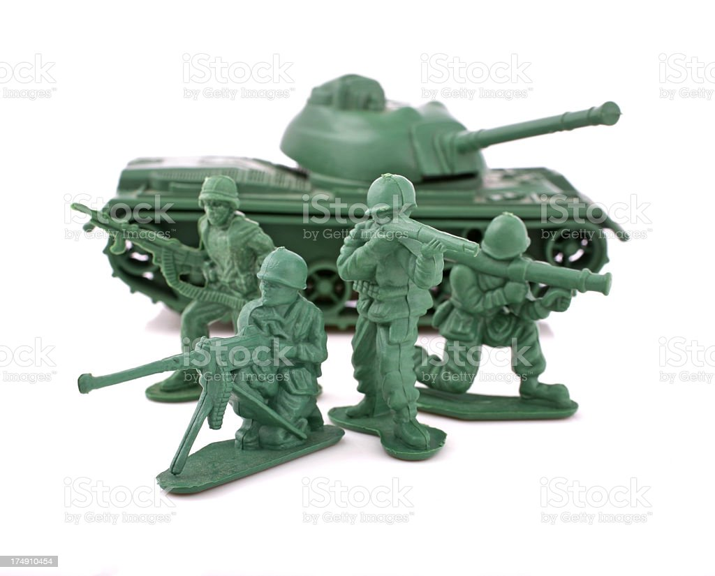 Green toy soldiers and an army tank stock photo