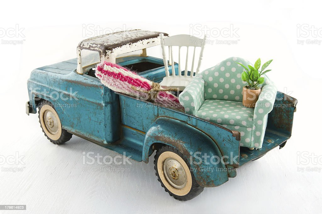 Green toy truck for moving houses stock photo