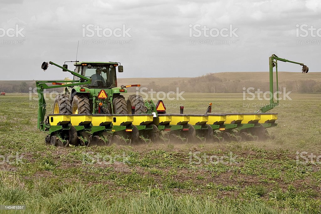 Green tractor working in a field stock photo