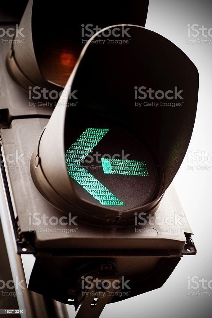 Green traffic light for turning left stock photo
