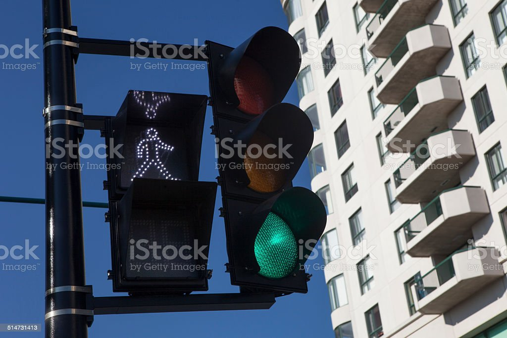 Green Traffic Light With Building in the Background stock photo