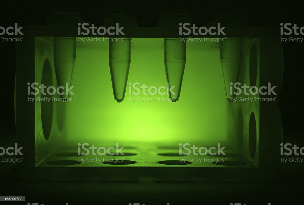 green tube research stock photo