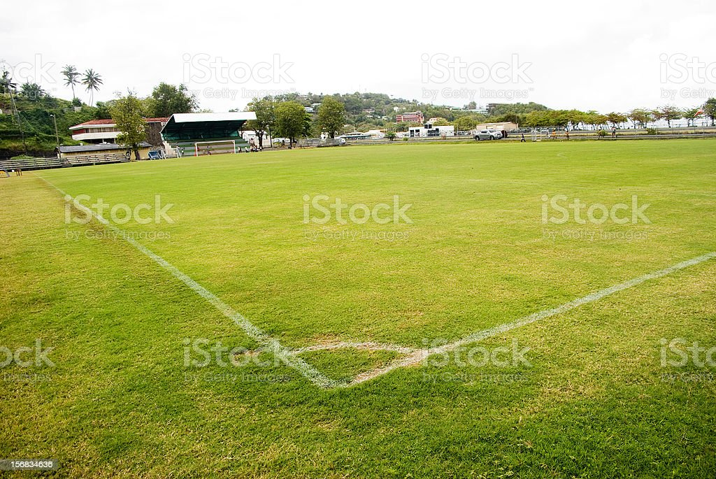 green turf playing field with corner box wide angle stock photo
