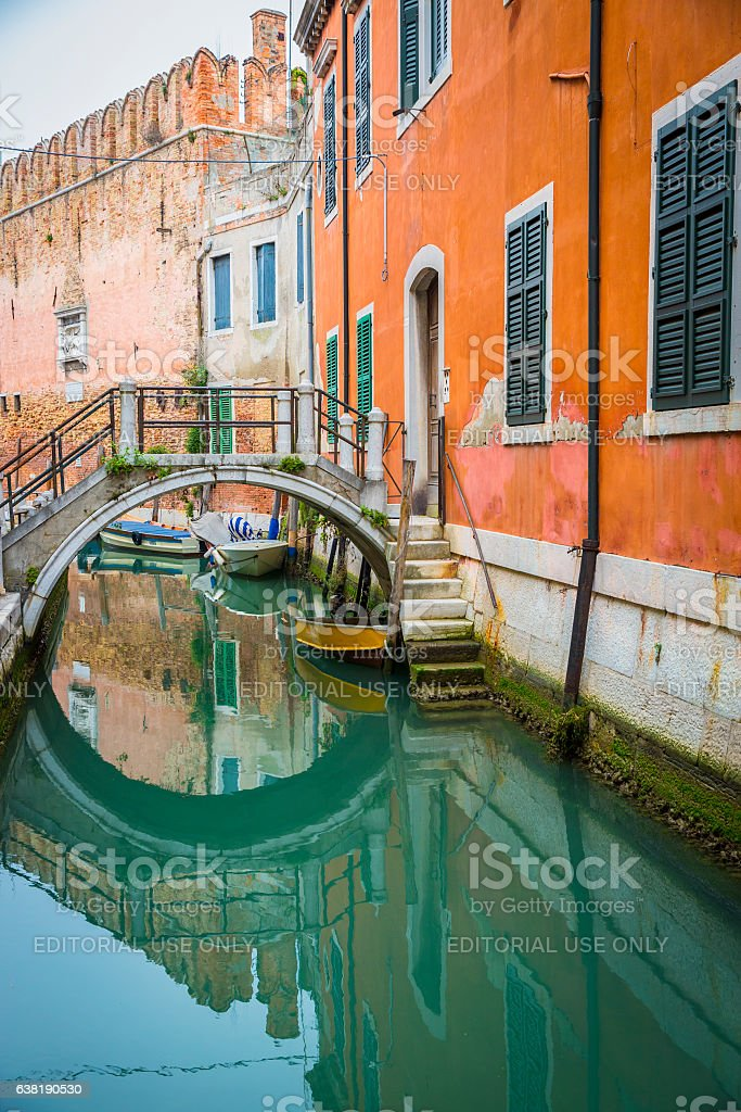 green turquoise romantic canal with small bridge, Venice, Italy stock photo